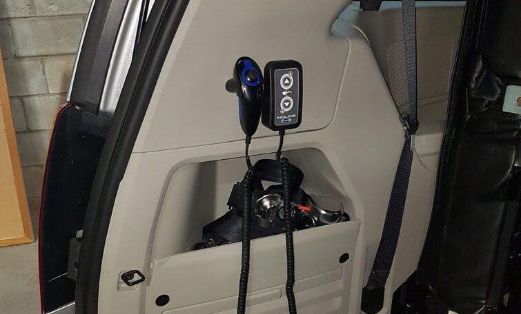 inqline system controls in wheelchair van