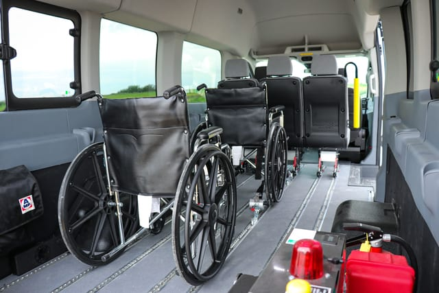 rear view of ford transit wheelchair van with six seats and one wheelchair position for group home and municipal transit programs