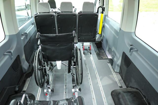 wheelchair loaded on rear entry hydraulic wheelchair van lift